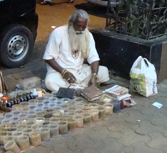 Back on the street below, this man sells Ayurvedic medicines and is an acknowledged expert in his field. No rent keeps his home made preparations affordable to many. He has had his practice for 50 years.