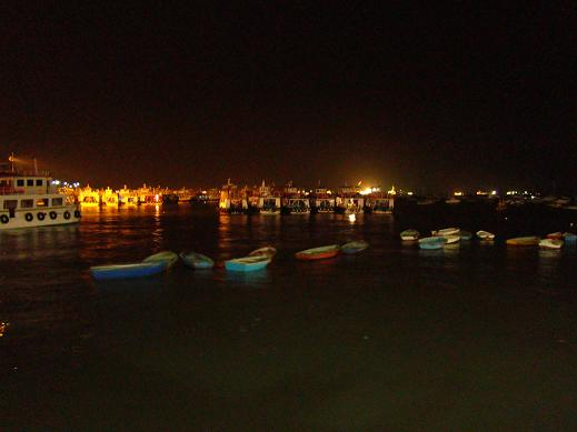 Fishing boats and local ferries are moored for the evening along the Apollo Bunder waterfront.